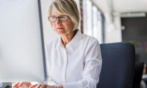 Woman outsourcing payroll