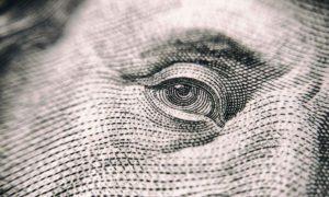 Ben Frankin's face on a 100 dollar bill