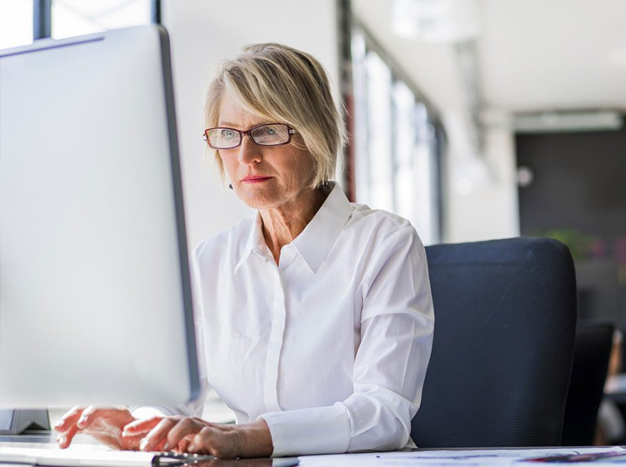 Woman works in front of a computer